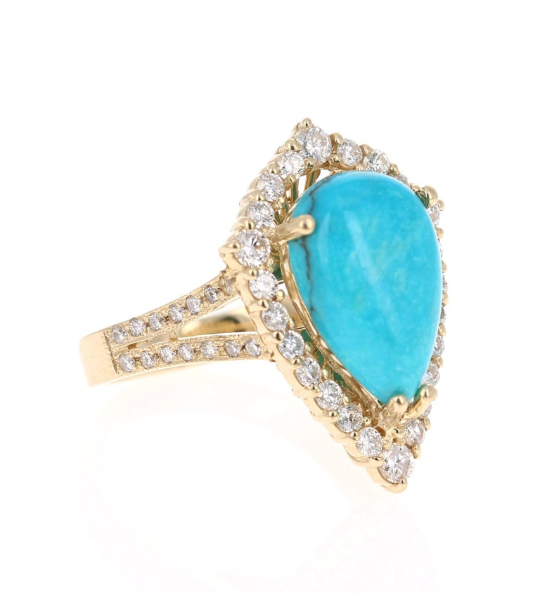 This is an exceptional and unique beauty!   The Pear Cut Turquoise is 4.48 Carats and is surrounded by a cluster of beautifully set diamonds. There are 50 Round Cut Diamonds that weigh 1.01 Carats. The total carat weight of the ring is 5.49 Carats.