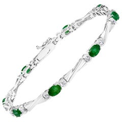 5.5 Carat Emerald 1 Carat Diamond Tennis Bracelet 14 Karat White Gold