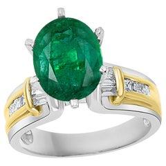 5.5 Carat Oval Cut Emerald and Diamond in 18 Karat/Platinum Two-Tone Ring Estate