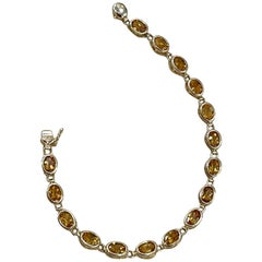 5.5 Carat Oval Shape Citrine Tennis Bracelet 14 Karat Yellow Gold