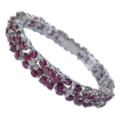 55 Carat Ruby Flower Motif Tennis Bracelet in 14 White Gold