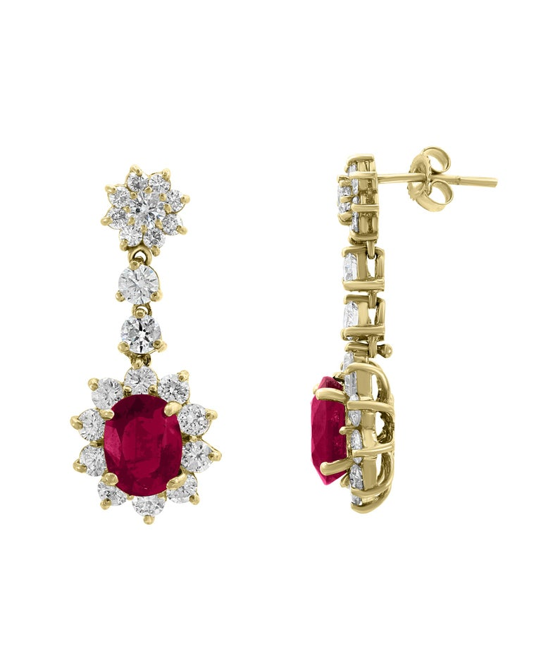 5.5 Carats  of two  Ruby   and  5 Ct Diamond  Hanging Earrings 18 K Yellow Gold This exquisite pair of earrings are beautifully crafted with 18 karat Yellow gold  weighing      8.0  grams  Ruby : 5.5 Ct Ruby is treated. Diamonds : approximately 5.0