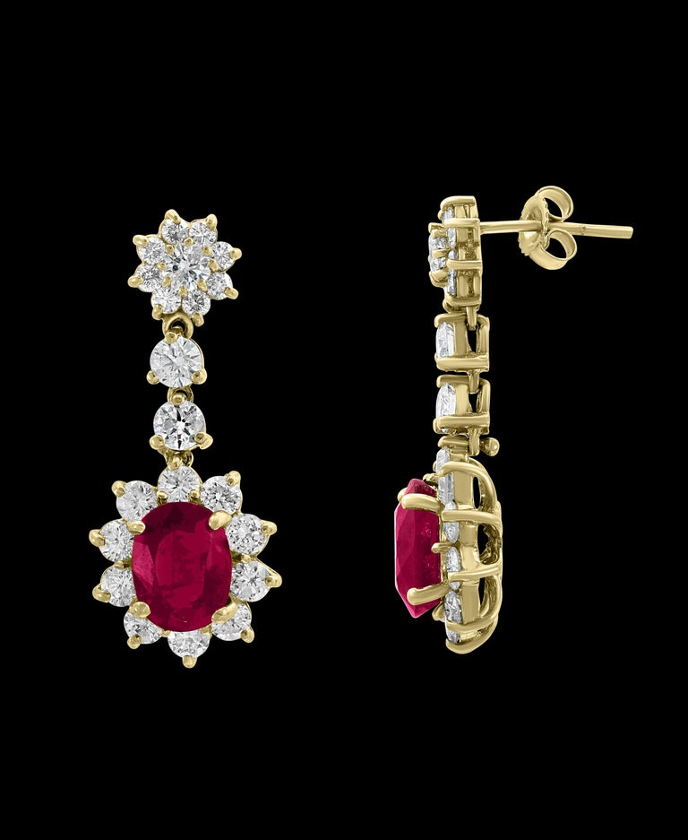 Oval Cut 5.5 Carat Ruby and 5 Carat Diamond Hanging or Chandelier Earrings 18 Karat Gold For Sale