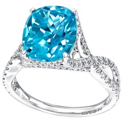 5.50ct Cushion Blue Topaz Engagement Ring 0.66 Carat Round Diamond in 18ct Gold