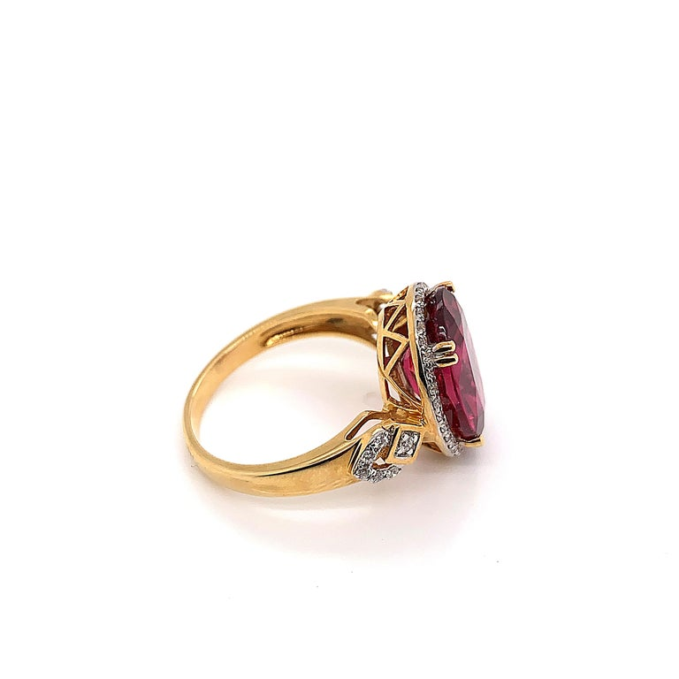 Contemporary 5.54 Carat Oval Shaped Rubelite Ring in 18 Karat Yellow Gold with Diamonds For Sale