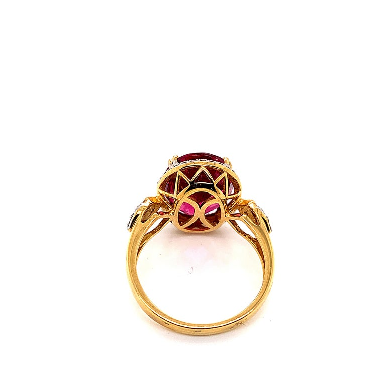 Oval Cut 5.54 Carat Oval Shaped Rubelite Ring in 18 Karat Yellow Gold with Diamonds For Sale