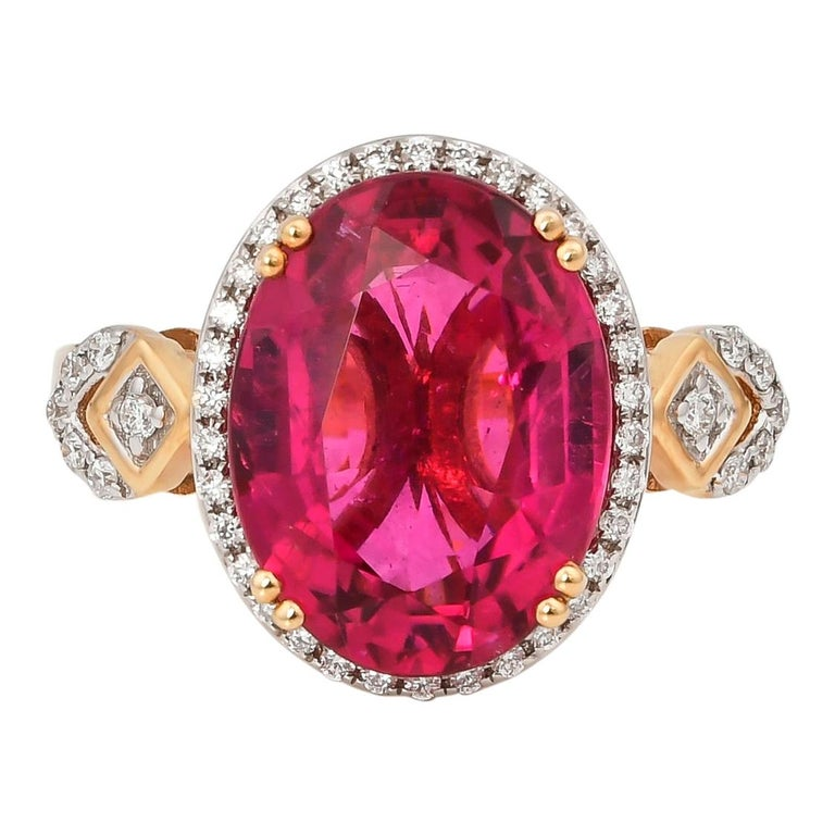 5.54 Carat Oval Shaped Rubelite Ring in 18 Karat Yellow Gold with Diamonds For Sale