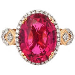5.54 Carat Oval Shaped Rubelite Ring in 18 Karat Yellow Gold with Diamonds