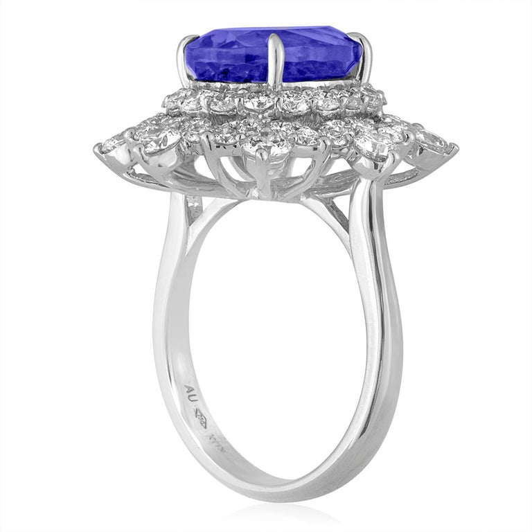 Large Cocktail Ring The ring is 18K White Gold There are 1.87 Carat in Diamonds F/G VS/SI The center stone is an Oval Tanzanite 5.58 Carats The ring is a size 6.5, sizable. The ring weighs 7.8 grams