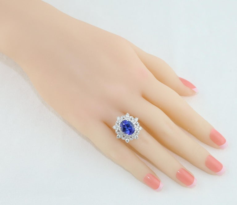 Contemporary 5.58 Carat Oval Tanzanite Diamond Cocktail Gold Ring For Sale