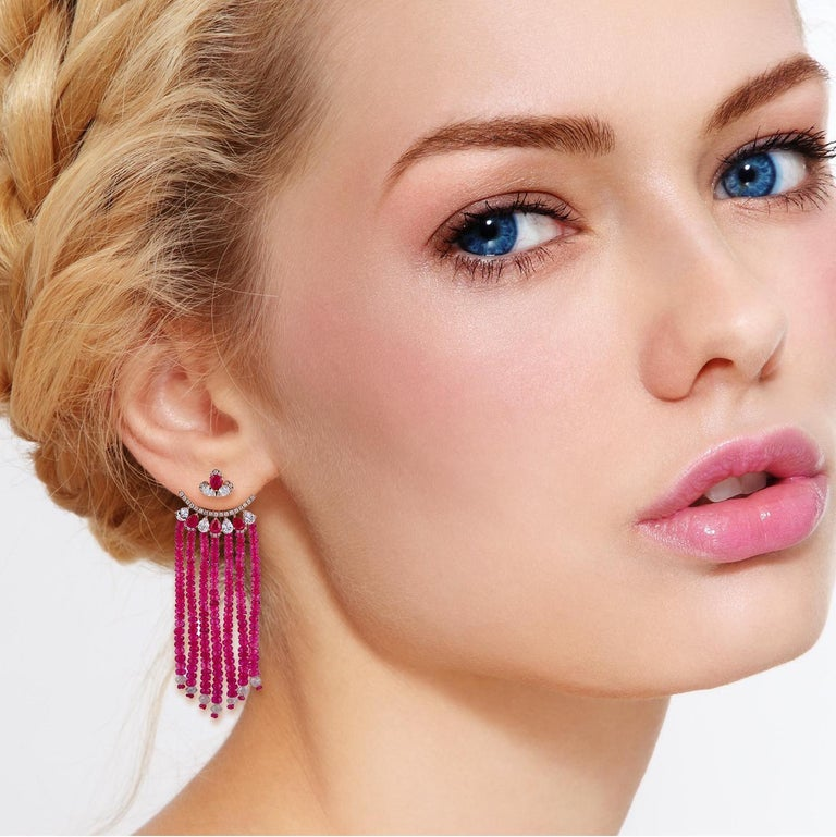 These stunning earrings are handmade in 18-karat gold, 55.81 carats ruby, 2.05 carats sapphire and set with 3.93 carats of glittering diamonds. Instock  FOLLOW  MEGHNA JEWELS storefront to view the latest collection & exclusive pieces.    Please