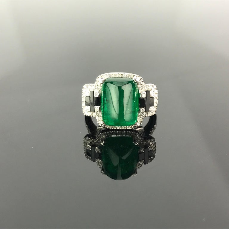 One of a kind cocktail ring using, transparent  5.62 carat Zambian Emerald with great lustre and beautiful colour adorned with Black Onyx and Diamonds. Currently a ring size US 6, but we can resize the ring for you without additional cost.