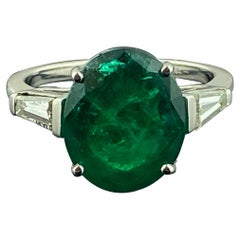 5.63 Carat Oval Emerald Ring Set in Platinum with Diamonds