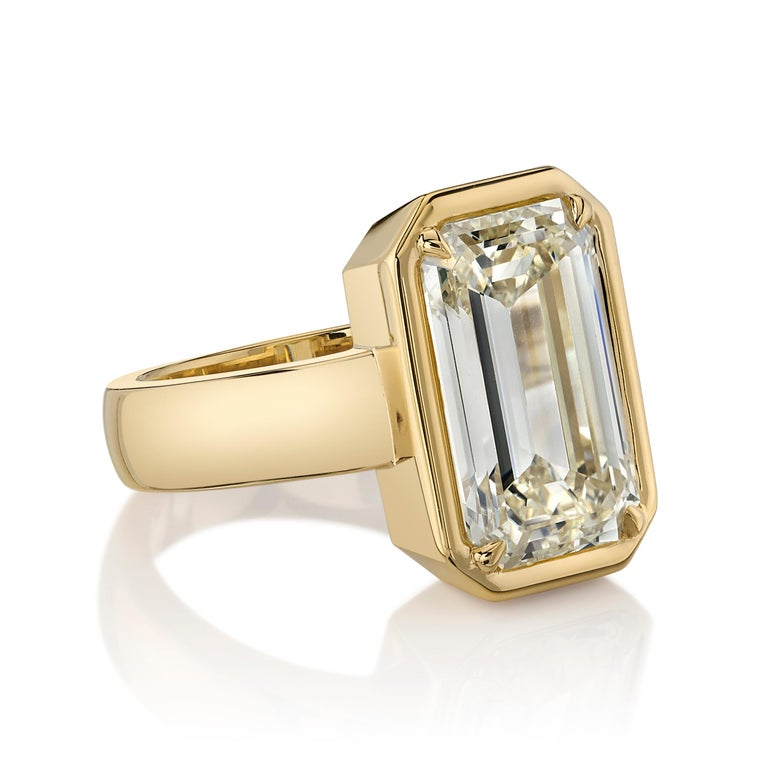5.64ctw W-X/SI1 GIA certified Emerald cut diamond set in a handcrafted 18K yellow gold mounting.  Ring is a size 6 and can be sized to fit.