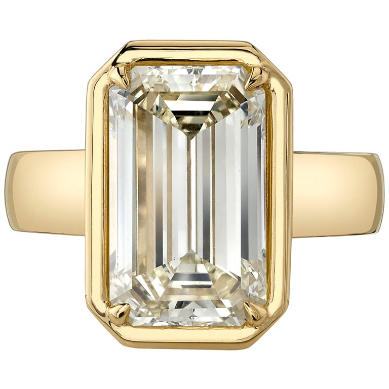 5.64 Carat Emerald Cut Diamond Set in a Handcrafted 18 Karat Yellow Gold Ring For Sale