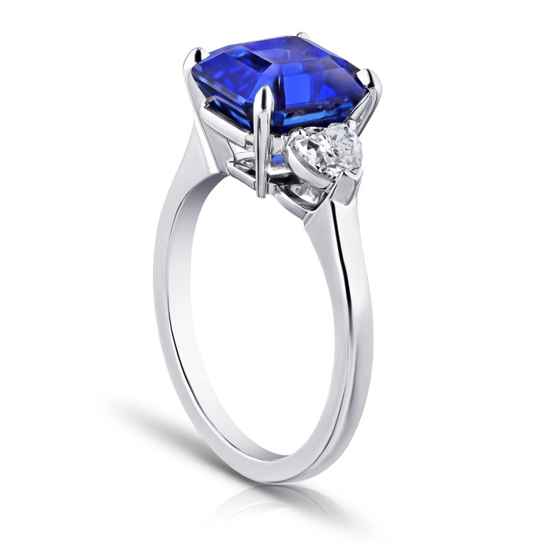 5.65 carat square emerald blue sapphire with heart shape diamonds .58 carats set in a platinum ring Size 7.