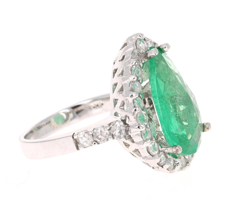 This is a gorgeous, gorgeous, gorgeous Emerald and Diamond Ring! This 14K White Gold Ring has a stunning  Pear Cut Emerald that weighs 4.51 carats. It has 28 Rose Cut Diamonds that weigh 1.16 carats. The total carat weight of this ring is 5.67