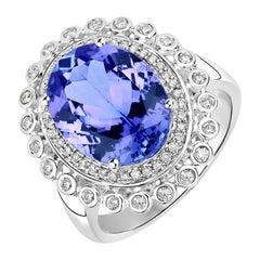 5.67 Carat Genuine Tanzanite and White Diamond 14 Karat White Gold Ring