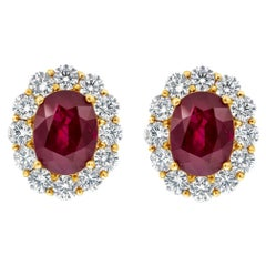 Roman Malakov, 5.69 Carat Oval Cut Ruby and Diamond Halo Omega Clip Earrings