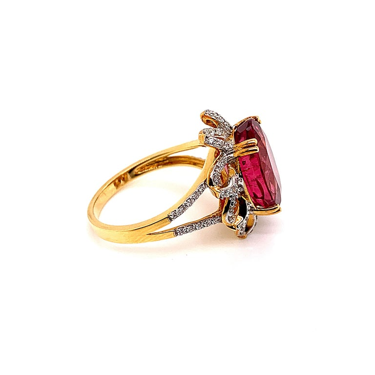 Oval Cut 5.69 Carat Oval Shaped Rubelite Ring in 18 Karat Yellow Gold with Diamonds For Sale