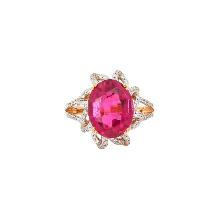 5.69 Carat Oval Shaped Rubelite Ring in 18 Karat Yellow Gold with Diamonds For Sale