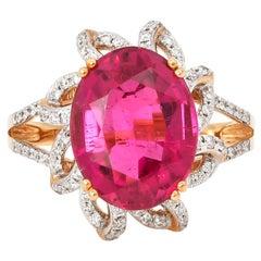 5.69 Carat Oval Shaped Rubelite Ring in 18 Karat Yellow Gold with Diamonds