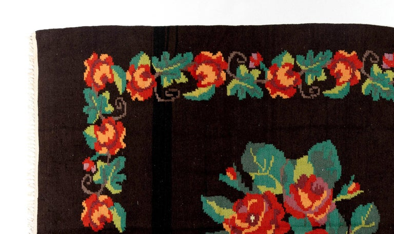 One of a kind vintage Bessarabian Kilim.   A handwoven Eastern European Rug from Moldova. These traditional Moldovan flat-weaves are inspired from vintage Aubusson carpets but they are distinguished with their black grounds, large floral patterns in
