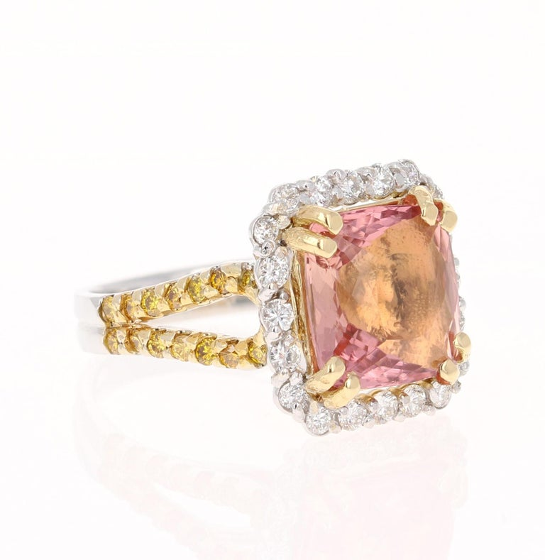 A unique beauty that is sure to be a rare piece!   This stunner has a gorgeous Square Cushion Cut Tourmaline that weighs 4.77 Carats. It is surrounded by 20 Round Cut Diamonds that weigh 0.50 Carats (Clarity: VS, Color: H) It is also embellished