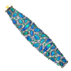 57.12 Carat Opal Emerald Tanzanite Diamond Bracelet Cuff
