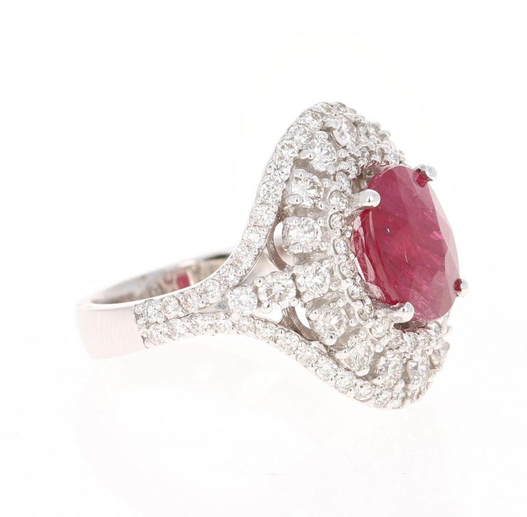 This ring has a beautiful Oval Cut Natural Ruby that weighs 3.97 Carats and is surrounded by 98 Round Cut Diamonds that weighs 1.80 Carats. (Clarity: VS, Color: H) The total carat weight of the ring is 5.77 carats.   Curated in 14 Karat White Gold