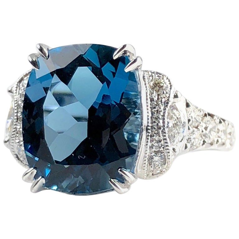 5.79 Carat Cushion Cut London Blue Topaz and 0.52 Carat Diamond Cocktail Ring For Sale