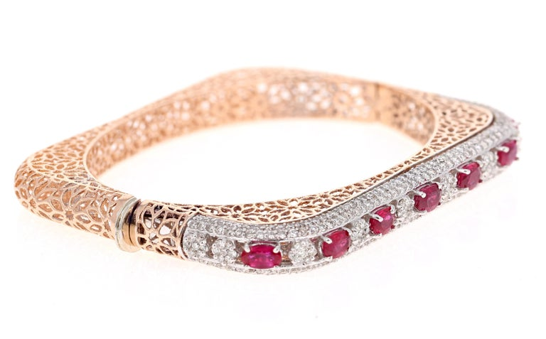 Stunning Statement Ruby Diamond Bangle!   This Bracelet has 7 Natural Oval Cut Rubies that weigh 2.94 Carats. It also has 308 Round Cut Diamonds that weigh 2.85 Carats. The total carat weight of the bracelet is 5.79 Carats. (Clarity: VS, Color: