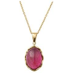 5.81 Carat Cabochon Dark Pink Tourmaline Pendant in 14 Karat Yellow Gold, Chain
