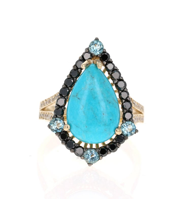 5.82 Carat Pear Cut Turquoise Topaz Black Diamond 14K Yellow Gold Bridal Ring!!  This ring has a 4.44 Carat Pear Cut Turquoise in the center of the ring and is surrounded by 20 Black Round Cut Diamonds that weigh 0.67 Carats.  The Ring is accented