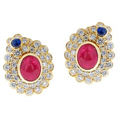 5.82 ct. Oval Ruby Cabochon and Sapphire Cabochon and Diamonds Earrings