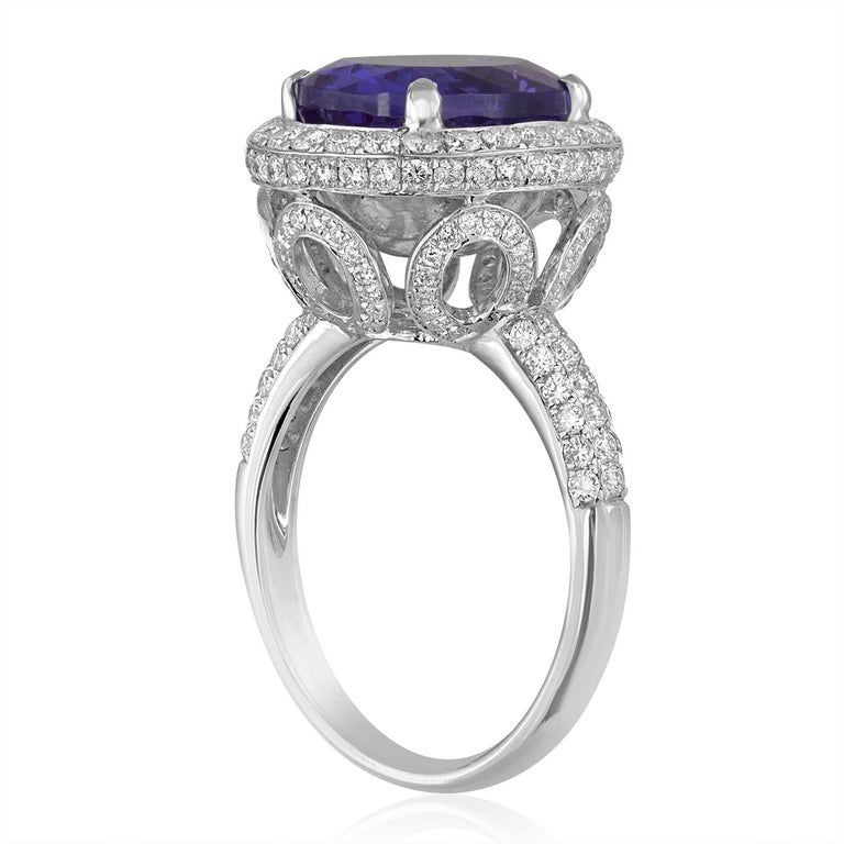 Stunning Tanzanite Ring The ring is 18K White Gold There are 1.50 Carats in Diamonds F VS The center stone is 5.83 Carats Oval Tanzanite The ring is a size 6.75, sizable. The ring weighs 7.0 grams.