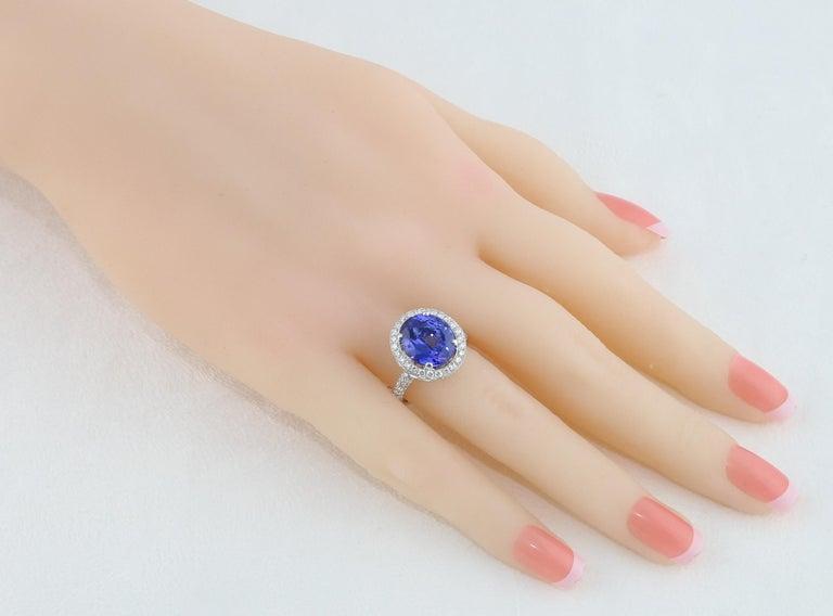 Modern 5.83 Carat Oval Tanzanite Diamond Gold Ring For Sale