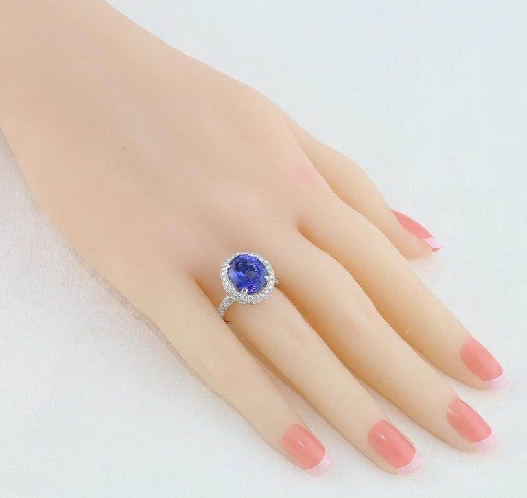 Oval Cut 5.83 Carat Oval Tanzanite Diamond Gold Ring For Sale