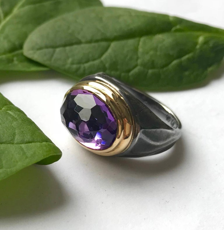 "K.Mita's Gem Rock Ring features a rounded 5.84ct amethyst that bursts out of an 18k yellow gold rim and rests on top of an oxidized sterling silver shank transformed by K.Mita's signature ""dune"" texture. The texture creates an illusion of movement"
