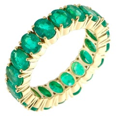 5.84 Carat Oval Cut Emerald Eternity Band in 18 Karat Yellow Gold