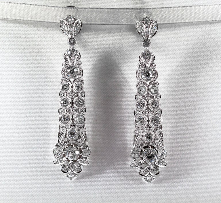 These Earrings are made of 18K White Gold. These Earrings have 5.85 Carats of White Old European Cut Diamonds. These Earrings are inspired by Renaissance Style. All our Earrings have pins for pierced ears but we can change the closure and make any