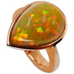 5.85 Carat Opal Ring Set in 18 Karat Gold Colorful Red, Green, Orange and Yellow