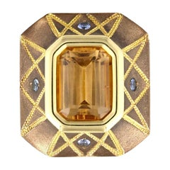 5.86 Carat Precious Topaz Ring in Bronze with Blue Sapphires