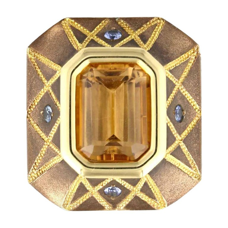 5.86 Carat Precious Topaz Ring in Bronze with Blue Sapphires For Sale