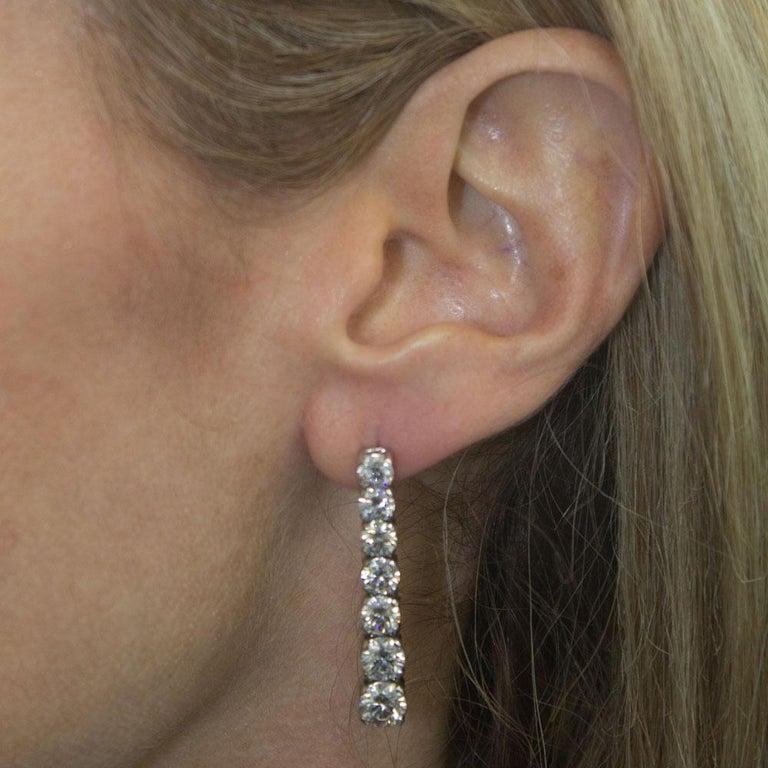 Round Cut 5.91 Carat Diamond Drop Graduated Earrings GIA Certified Diamonds D-F Color For Sale