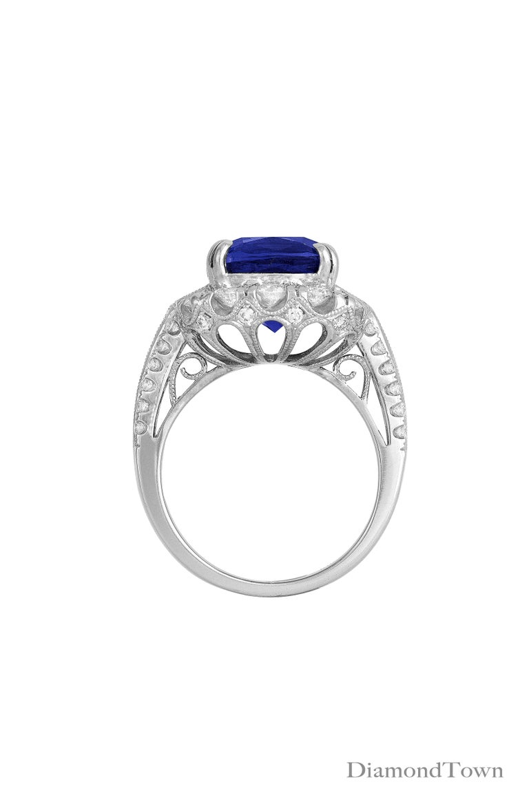 Contemporary GIA Certified 5.96 Carat Tanzanite and 1.47 Carat Diamond Cocktail Ring For Sale