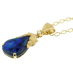 5.98 Carat Black Opal and 18 Karat Gold Hand-Engraved Necklace Handmade in Italy