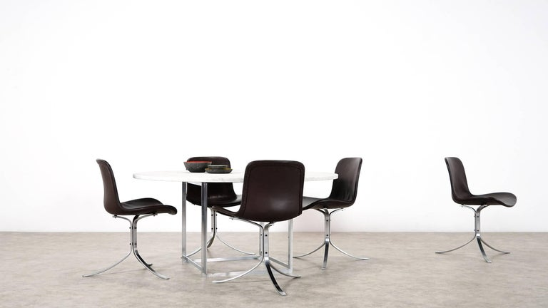 Five Poul Kjærholm - PK9 Dining Chairs - 1985 by Fritz Hansen, Denmark in dark brown leather.  The legendary PK9 chair, designed by Poul Kjaerholm in 1960. It is said, that Kjaerholm's incessant quest for the perfect shape led him to design the