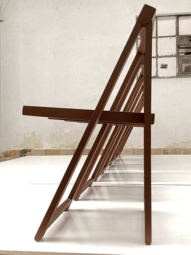 Nice functional set of 6 folding dining chairs by Aldo Jacober for Alberto Bazzani, Italy, 1966.  Original brown stained Birch wood that is in good and hardly used condition  The construction and design make it possible to reduce the volume of 6