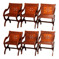 6 Antique Gothic Carved & Cut-Out Oak Curule Form Armchairs, circa 1900